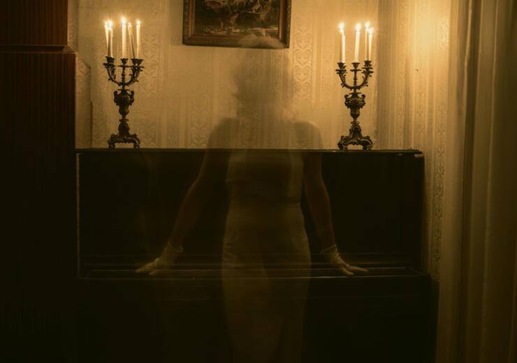 Female Ghost Against Piano In Darkroom