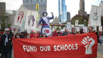 National News - Chicago's Teachers Go On Strike, Set Up Picket Lines Outside Public Schools