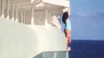 Weird News - Woman Takes Selfie Hanging Over Cruise Ship Railing, Gets Lifetime Ban
