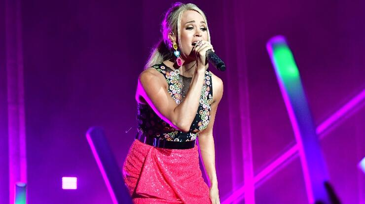 Carrie Underwood Jokes Her Stage Is 'Dangerous' After She Trips During Show | iHeartRadio