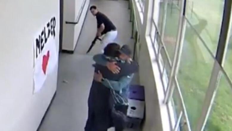 Video Shows High School Coach Disarming, Huggin Shotgun-Wielding Student