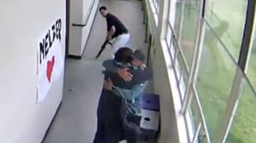 National News - Video Shows High School Coach Disarming, Huggin Shotgun-Wielding Student