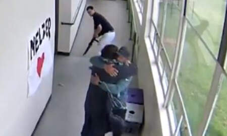 National News - Video Shows High School Coach Disarming, Hugging Shotgun-Wielding Student