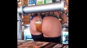 The News Junkie - Bartender Serves Beer With Her Ass