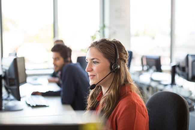 Female customer representative working in office