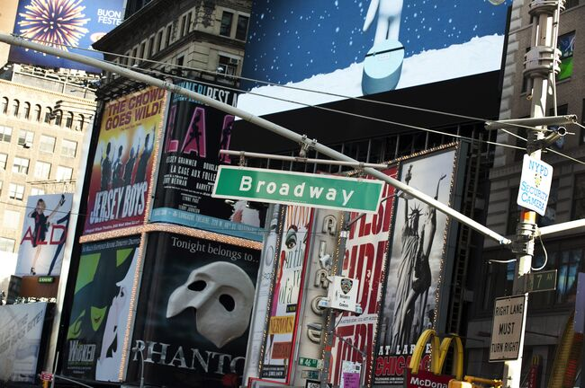 A street sign hangs over Broadway in Tim