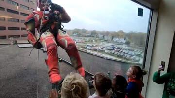 Bill Cunningham - SWAT Team In Superhero Costumes Rappel Into Hospital To Surprise Children