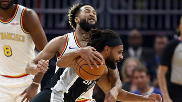Sports Desk - Spurs top Warriors 127-110