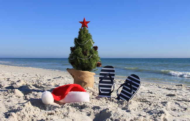Santa was here. Decorated Christmas tree on the beach.