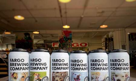 Weird, Odd and Bizarre News - North Dakota Brewery Features Dogs Available for Adoption on Cans