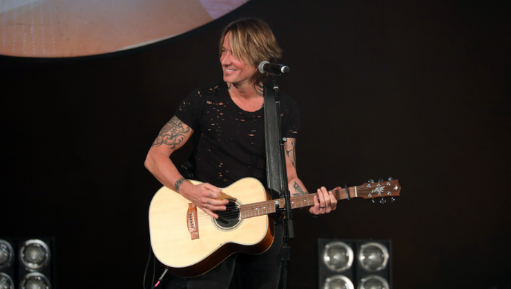 Keith Urban Invites Little Girl On Stage To Sing 'Wasted Time' With Him | iHeartRadio