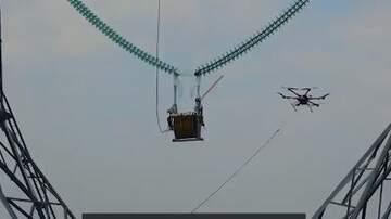 image for Drone Used To String High Tension Power Lines