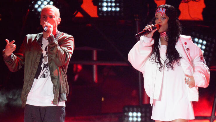 Eminem's Rep Addresses His Lyric About Siding With Chris Brown Over Rihanna | iHeartRadio