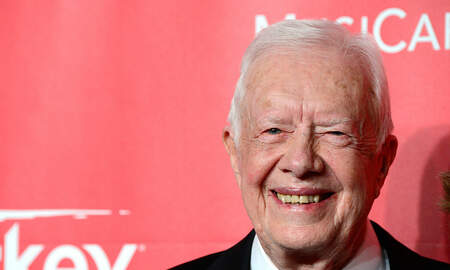 National News - Jimmy Carter 'Up and Walking Following Brain Surgery, Pastor Says