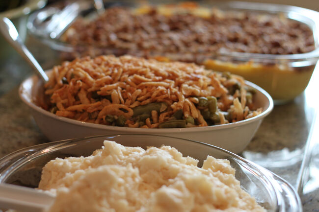 Mashed potatoes, green bean casseroles and sweet potato side dishes await to be served