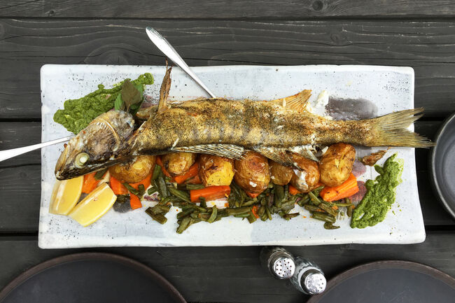 Whole baked fish with vegetables