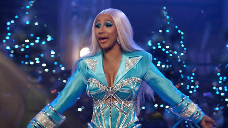 Cardi B Plays Santa, Spreads The Wealth In New Holiday Ad For Pepsi | iHeartRadio