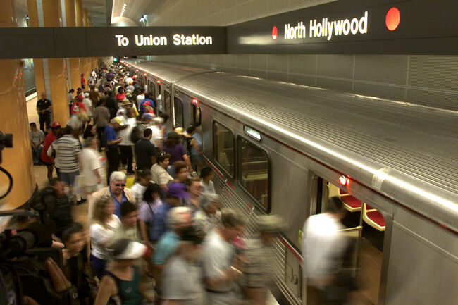 A group at the North Hollywood station files aboard taking advantage of the free rides on the Metro