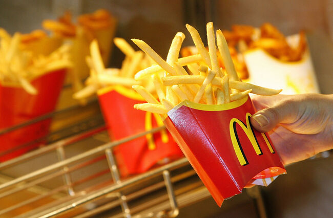 A McDonald?s employee makes French fries