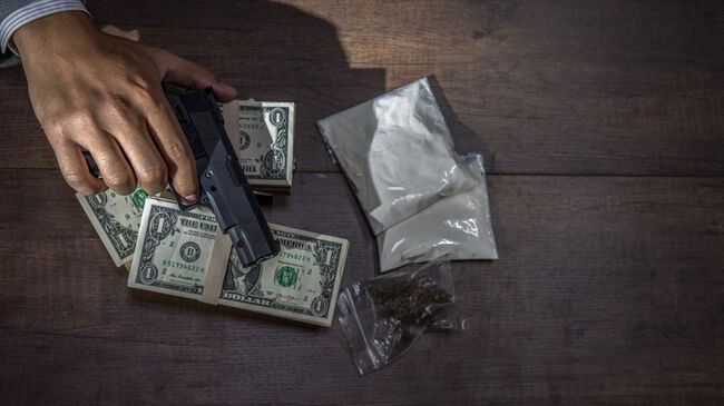 Drug trafficking, crime, addiction close up of hands with drugs and money