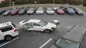 Steve & Gina's Page - A Car Flies Into Air Over Dozens of Vehicles at Car Dealership!