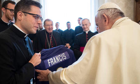 Sports Top Stories - Baltimore Ravens Give Pope Francis A Custom Jersey Signed By Lamar Jackson