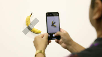 Weird, Odd and Bizarre News - Performance Artist Eats Banana Duct-Taped to A Wall That Sold For $120,000