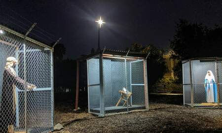Politics - Nativity Scene Depicts Jesus, Mary and Joseph as Refugees in Cages