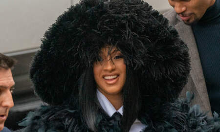 Trending - Cardi B's Latest Over-The-Top Courtroom Outfit Featured Feathers & A Train