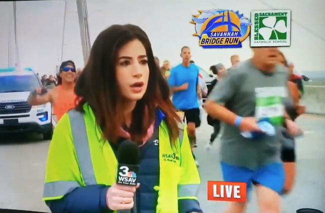 runner smacks reporter's butocks charged