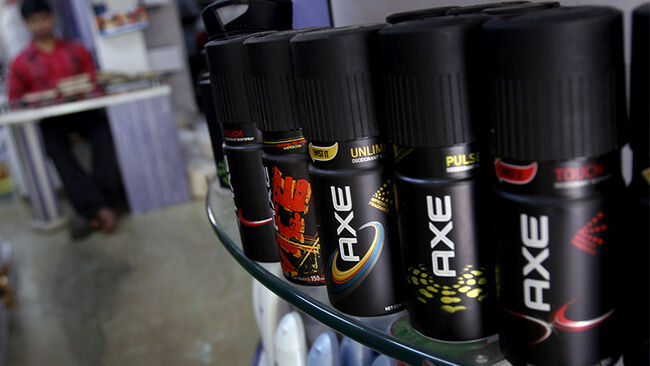 Cans of Axe body spray, made by Hindustan Unilever Ltd., sit