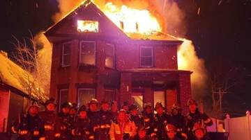 Mike McConnell - Detroit firefighters' photo in front of flaming house draws fire