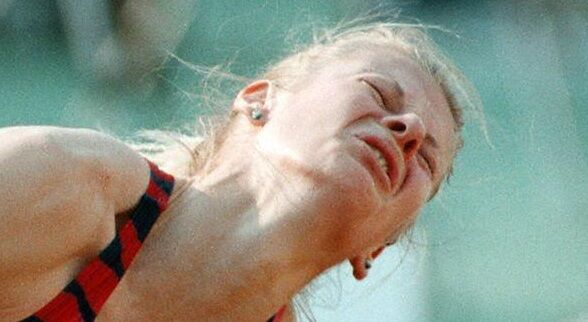 Russia's Anna Biryukova grimaces in pain