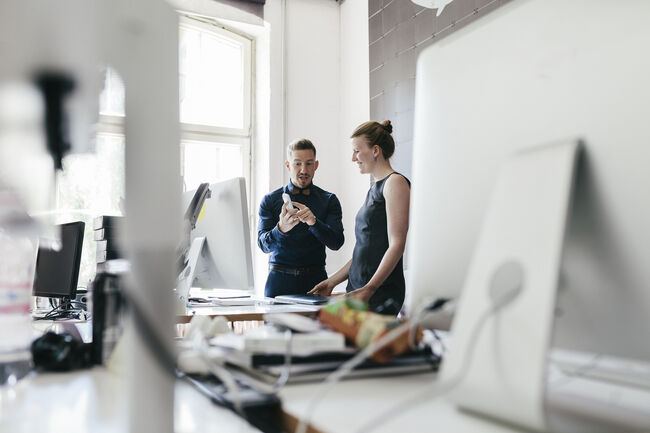 Startup Business Manager Talking To Employee