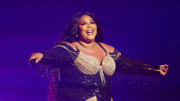 image for Lizzo Fits Wine, A Wig, An Outfit, A Remote & MORE In Her Micro Purse