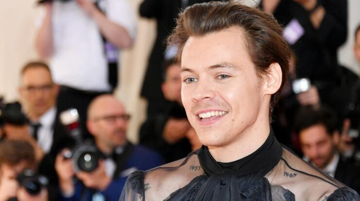 Harry Styles' Fans Are Begging Him To Back Out Of Super Bowl Performance | iHeartRadio