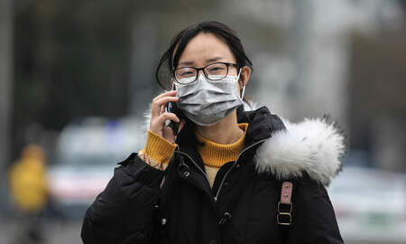 National News - More Coronavirus Cases in China as Virus Spreads to Beijing