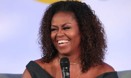 Entertainment News - Michelle Obama's 2020 Workout Playlist Features Lizzo, Cardi B & More