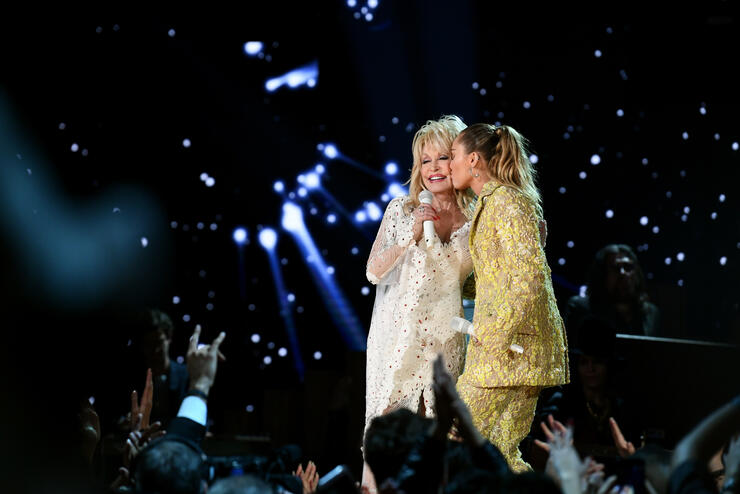 Miley Cyrus Pays Tribute to Godmother Dolly Parton With Fun Backstage Clip  | iHeartRadio