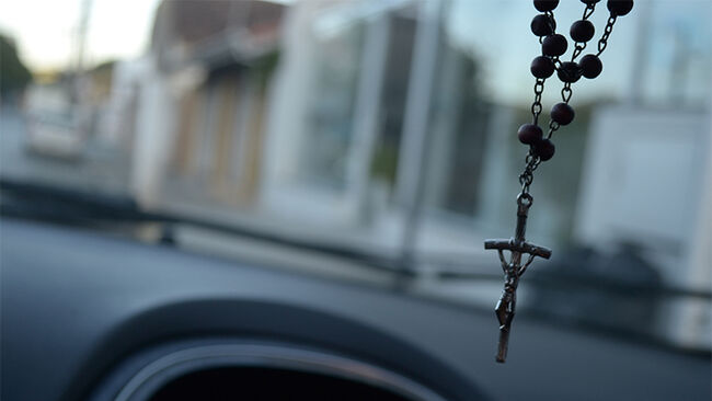 Close-Up Of Crucifix Hanging In Car
