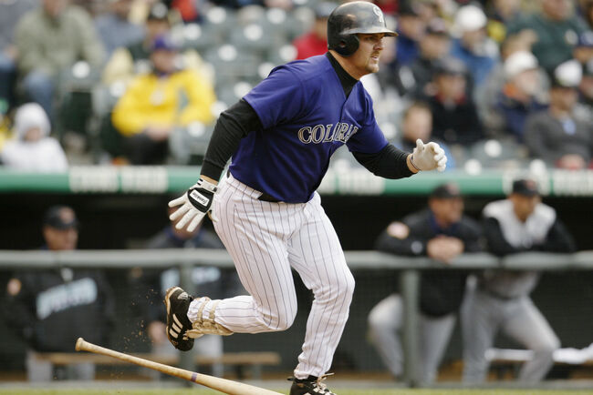 Larry Walker runs to first base