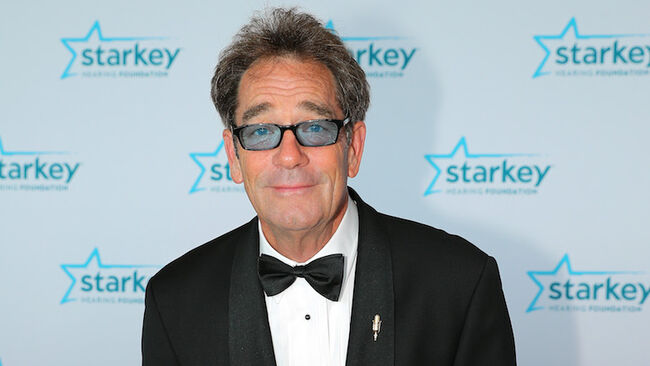 Huey Lewis Unable To Sing, Perform Due To 'Debilitating Hearing Loss'