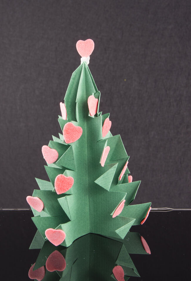 Christmas origami tree. More and more people are using their mobile phones to learn how to do crafts