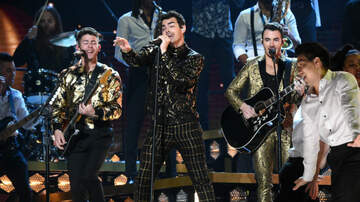 Entertainment News - Jonas Brothers Deliver Fiery 'What A Man Gotta Do' Grammy Performance