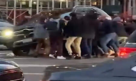 National News - Video Shows Good Samaritans In New York City Lifting SUV Off Trapped Woman
