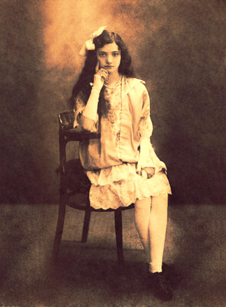 Vintage girl sitting in front of the camera