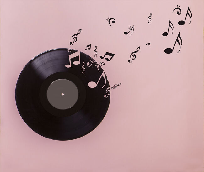 Vinyl record on pink background. Several musical notes are born of the vinyl record
