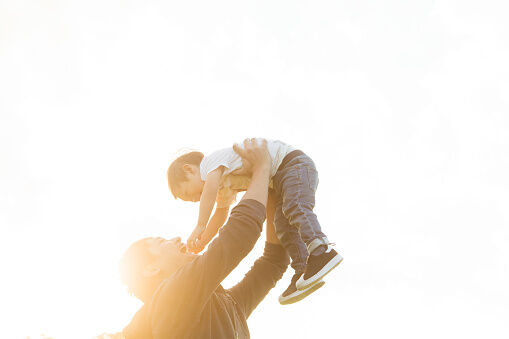 A father lifting his son