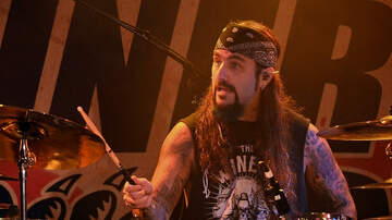 image for Watch Mike Portnoy Perform Neil Peart Tribute On A Toy Drum Kit