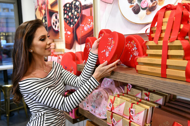 Million Dollar Listing New York Stars, Ryan Serhant And Emila Bechrakis Serhant, Shop For Valentine's Day Gifts At The Godiva Cafe Located In NYC'S Flatiron District